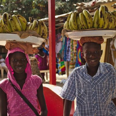 A boy and a girl selling bananas in the market in Banjul, Gambia.