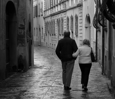 Couple walking in Castiglion Fiorentino, Italy
